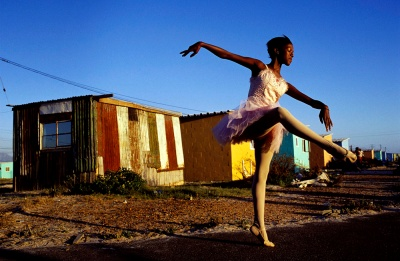 Ballet dancer strikes a pose outside her home in Khayelitsha